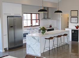 Modern kitchen with luxurious stone island bench
