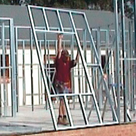 Steel Frame Kit Home: Numbered, preassembled framing sections and roof trusses made from Hi-tensile steel.