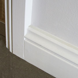 Kit Home skirting and architraves suitable for painting. 90mm Colonial floor skirtings to  all rooms and built-ins.  70mm architraves around all windows and doors. Finish as above.