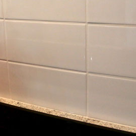 Ceramic tiles for floor, wall, kitchen and weta areas included with kit home.
