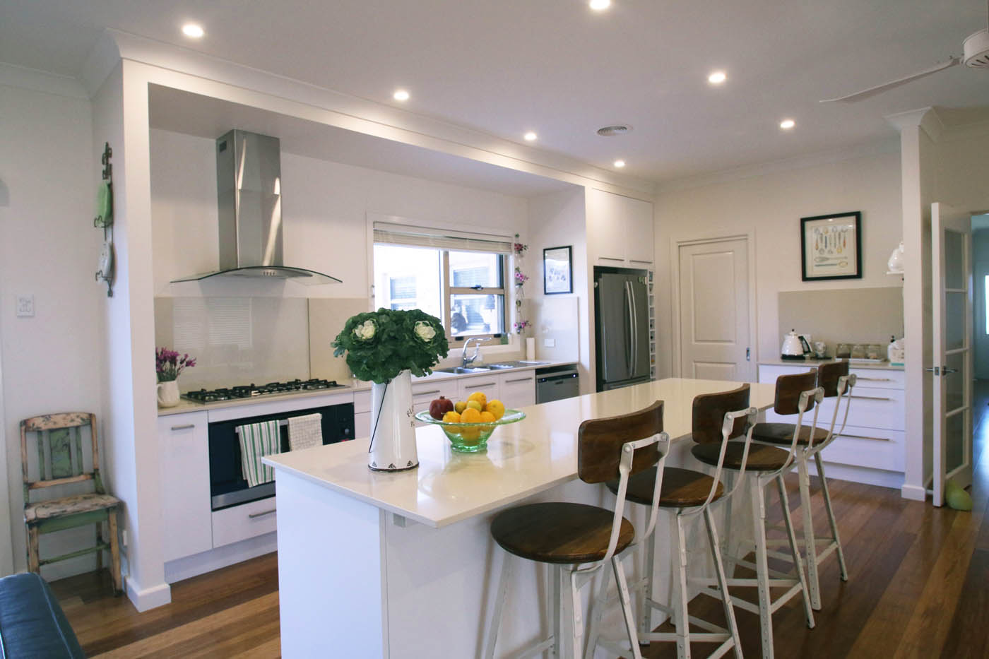 Rustic stools in clean white kitchen