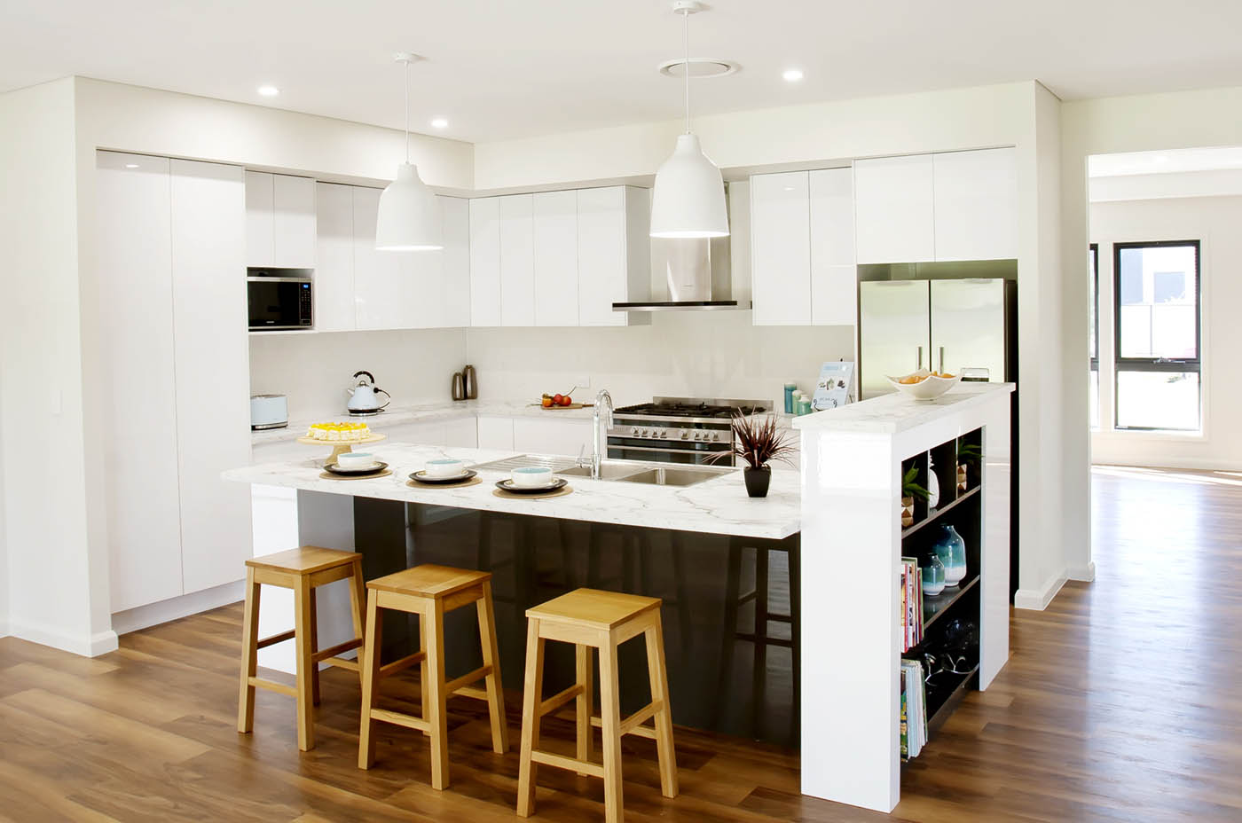 Contemporary white kitchen with island bench