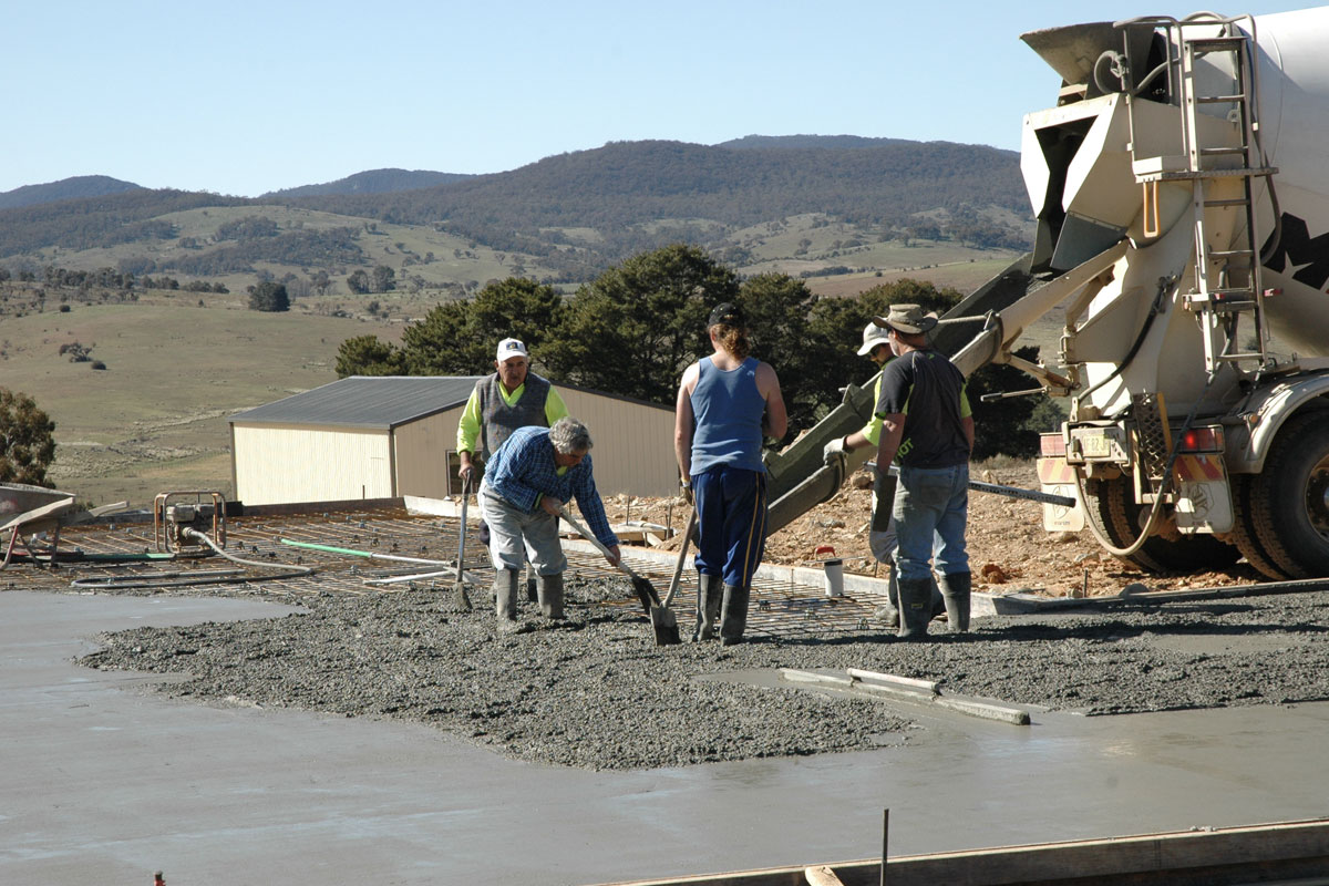 Kit home concrete slab being laid