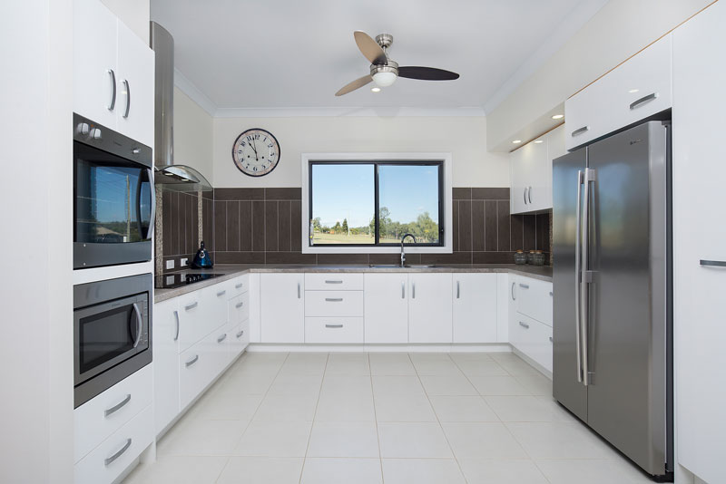 The Borgs got to built the kitchen of their dreams with the money they saved when working with PAAL Kit Home's flawlessly simply designs. Home building for NSW, QLD and VIC.