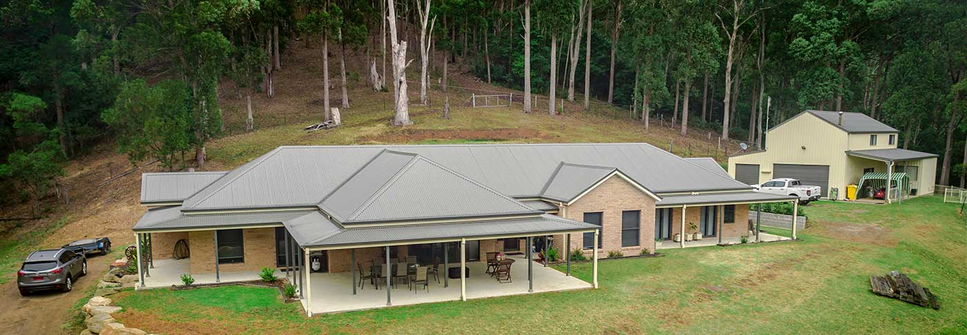 Aerial shot of newly built Dewhurst home with ample space and living room. What a wonderful dwelling, and over looking the Illawara NSW plains. It really unfolds in front of you.