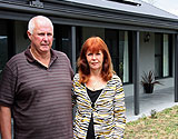 Elderly couple in front of new Paal kit home