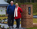 Couple standing near new home letter box
