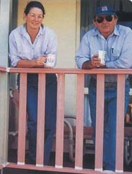 Colin and Leigh on verandah with coffee