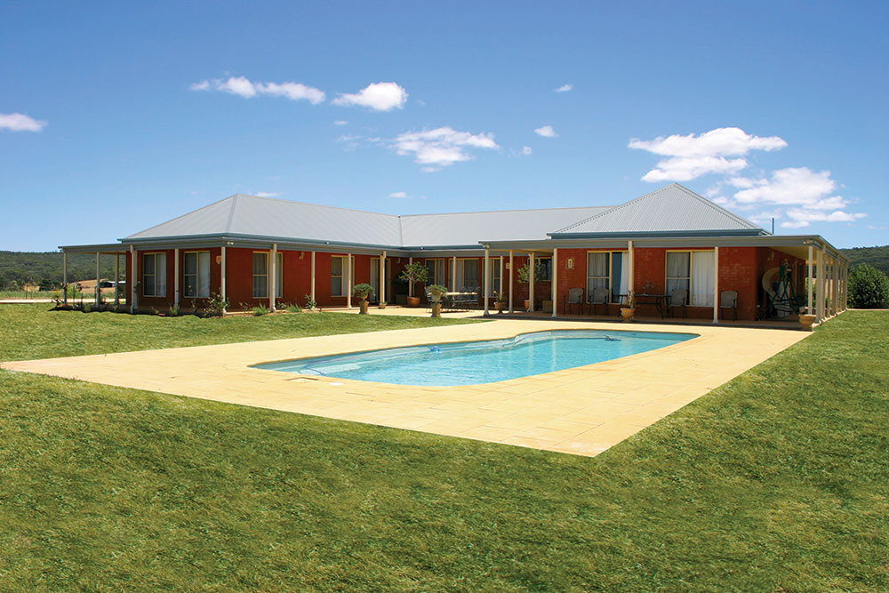 Backyard of the steel frame kit home with swimming pool. PAAL Kit Homes NSW VIC QLD