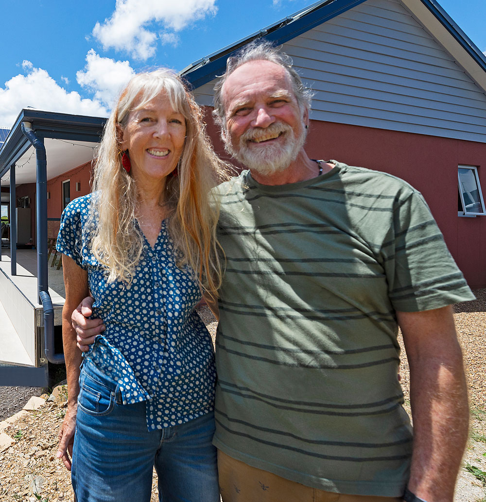 Hild & Hans infront of new home