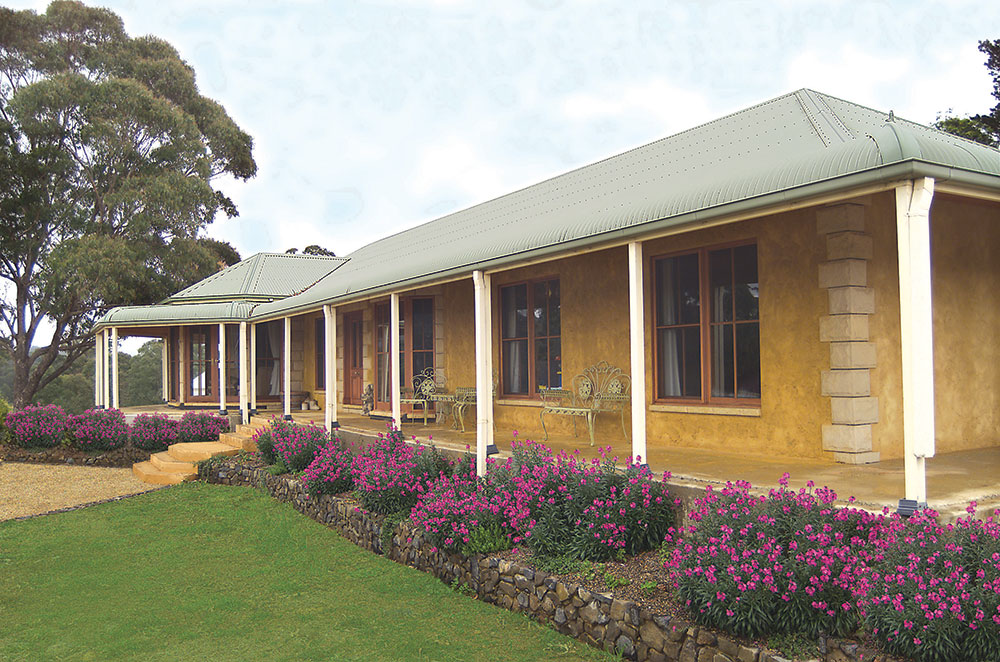 Front verandah of kit home with landscaping