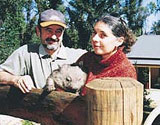 Lett's holding their wombat in front of new owner built kit home