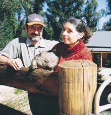 Vickii and Danny at fence with wombat