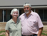 Tamworth couple in front of completed home