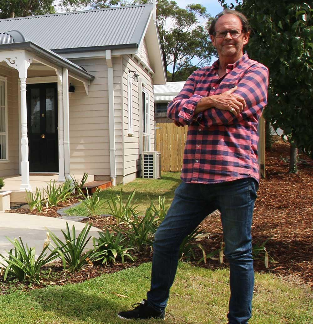 Tony standing in kit home garden