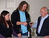 Family celebrating completion of new kit home with wine